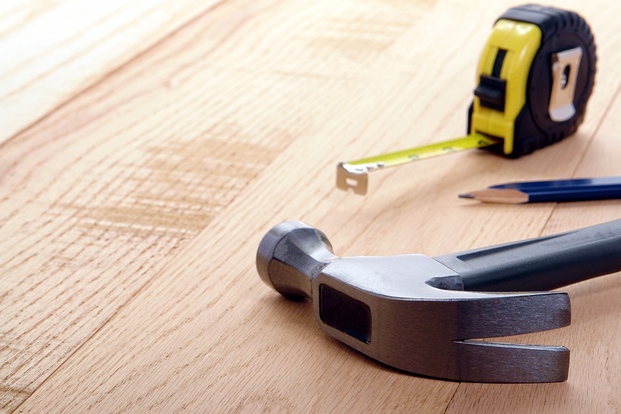 Carpenter Tools With Hammer And Tape Measure