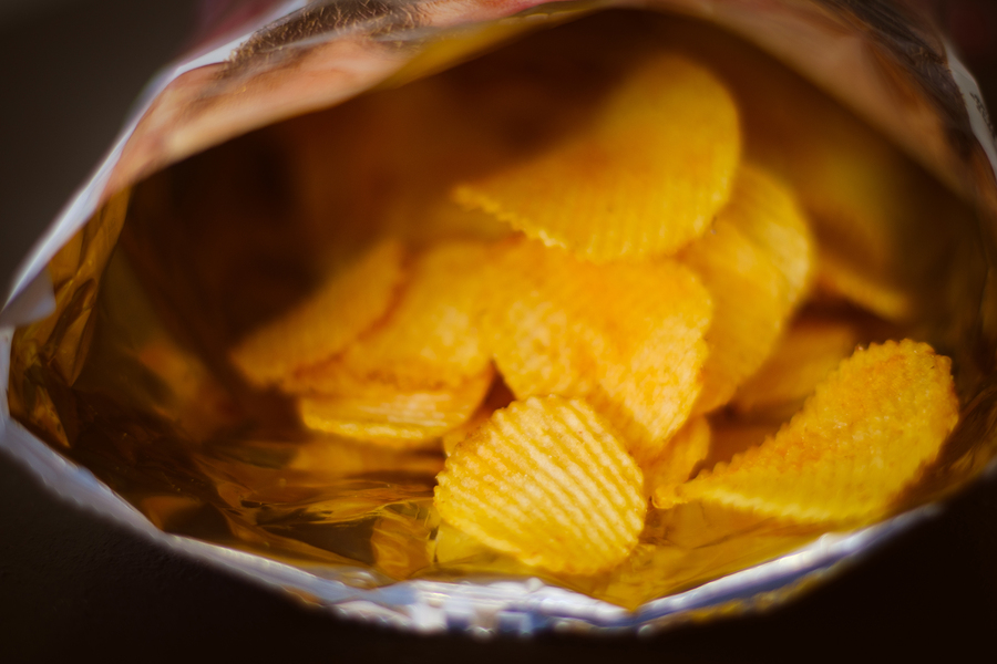 potato chips. delicious beer chaser. best food for quick snack. crunchy spicy crisps in a bag