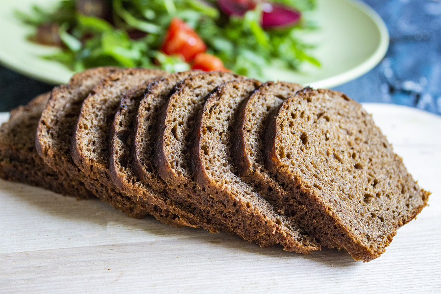 Sliced Hovis bread on a chopping board.